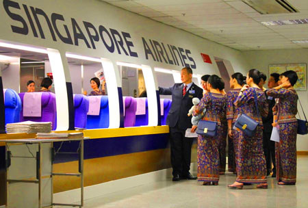 транзитом через Сингапур
