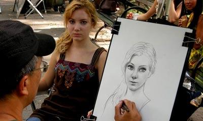 уличный художник в Индии